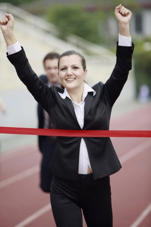 Businesswoman crossing the finishing line photo