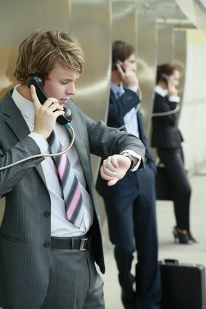 Business people using public telephones Stock Photo - 8148685