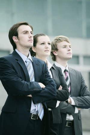 european ethnicity: Business people standing with arms crossed