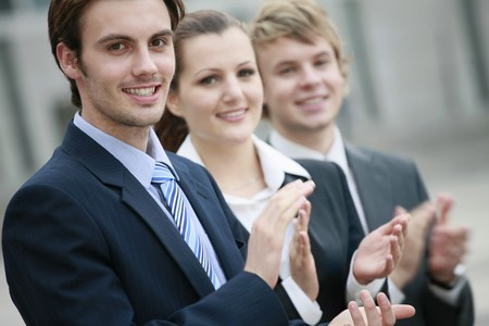 success focus: Business people clapping hands Stock Photo