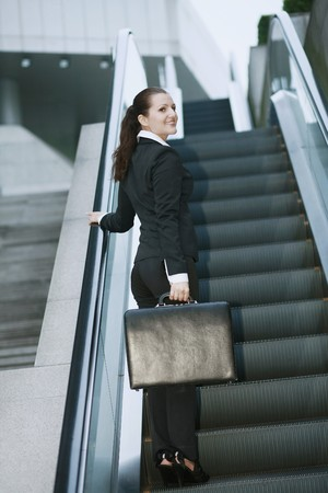 Businesswoman on escalator Stock Photo - 8149264