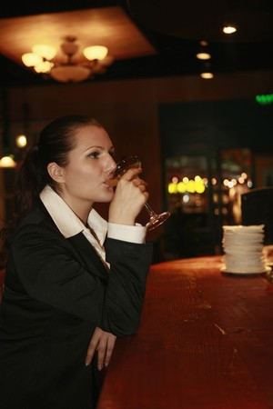 Businesswoman enjoying a glass of cocktail Stock Photo - 8148475