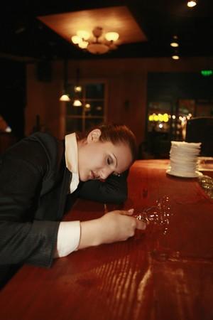 Drunk businesswoman sleeping on bar counter photo