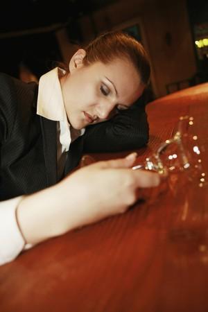 Drunk businesswoman sleeping on bar counter Stock Photo - 8148417