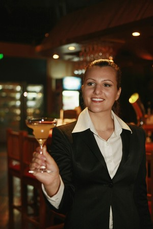 Businesswoman holding a glass of cocktail Stock Photo - 8149104