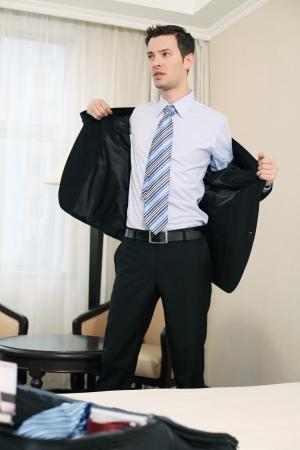 Businessman taking off his suit photo