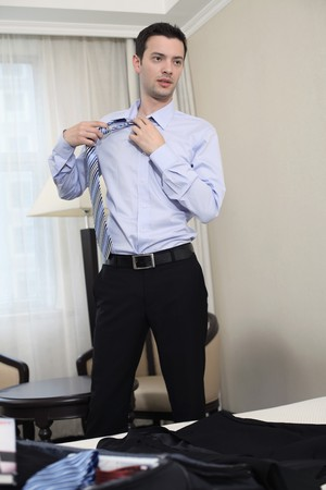 Businessman removing his tie photo