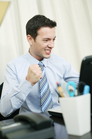 Businessman cheering and showing fist photo