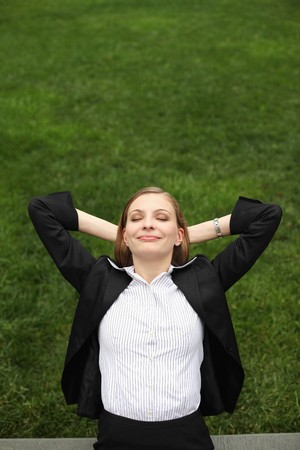 Businesswoman with hands behind head smiling Stock Photo - 8148923