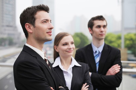 eastern european ethnicity: Business people standing outdoors with arms crossed Stock Photo