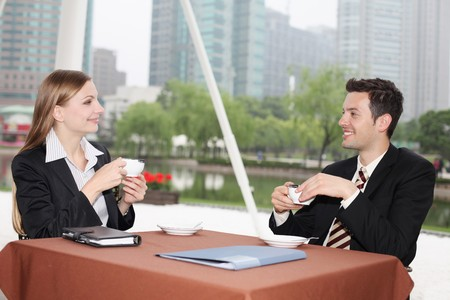 Business people enjoying coffee at outdoor cafe Stock Photo - 8148407