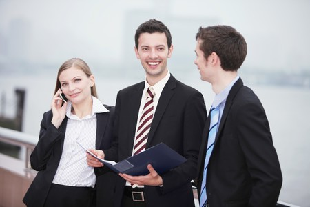 Business people talking to each other outdoors photo