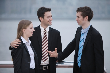 introducing: Businessman introducing his partner to another businessman
