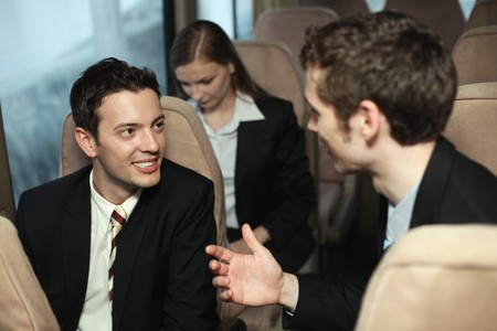 southeastern european descent: Businessmen talking to each other, businesswoman in the background
