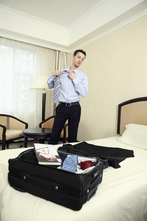 Businessman removing tie photo
