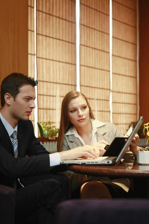 Business people having discussion at cafe Stock Photo - 8148739