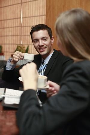 southeastern european descent: Business people enjoying coffee Stock Photo