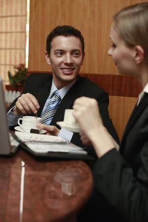 Business people enjoying coffee photo