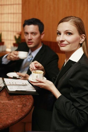 Business people having discussion at cafe photo