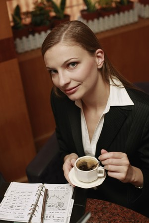 Businesswoman enjoying coffee at cafe Stock Photo - 8148636