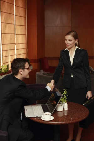 Business people shaking hands in a cafe Stock Photo - 8148468