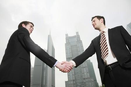 shaking hands business: Businessmen shaking hands