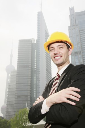 Businessman wearing safety hat with arms crossed Stock Photo - 8148369