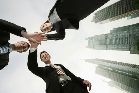 Business people with hands together photo