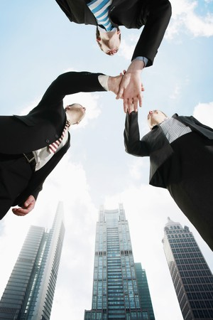 Business people with hands together