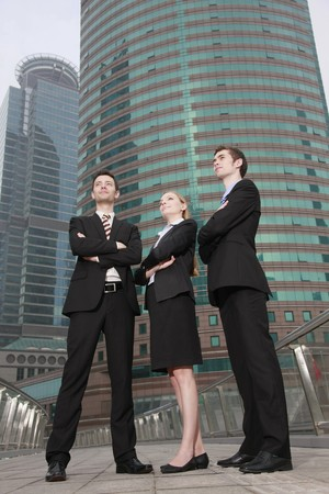 Business people standing outdoors with arms crossed Stock Photo - 8149051