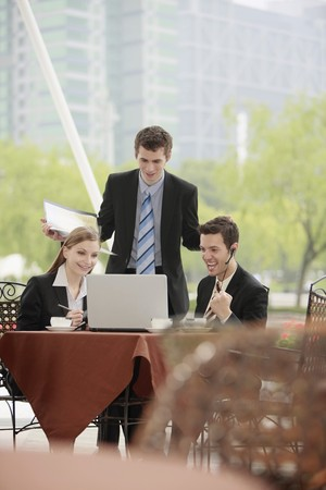 Business people working together at outdoor cafe photo
