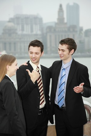 southeastern european descent: Business people talking to each other outdoors