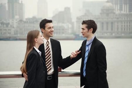 businessman talking: Business people talking to each other outdoors