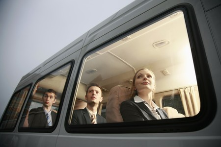 Business people in a van looking out through the window Stock Photo - 8148532