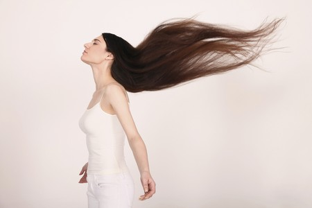 Woman with hair blowing in the wind Stock Photo - 8148499