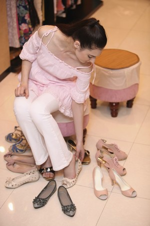 Woman trying on shoes photo