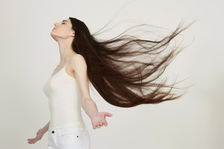Woman with hair blowing in the wind photo
