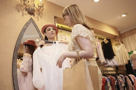 eastern european ethnicity: Women shopping at clothes store