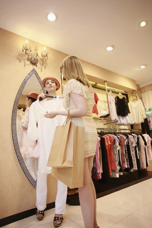 Women shopping at clothes store photo