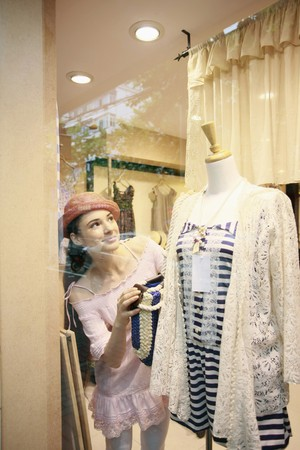 Woman looking at clothes on mannequin on display photo