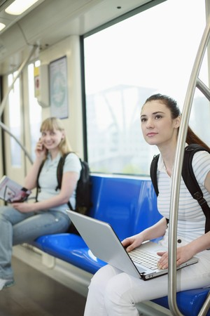 Women sitting in subway train photo