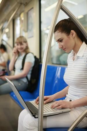 Women sitting in subway train photo