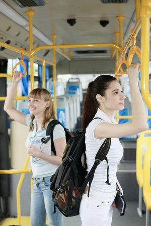 public transportation: Women travelling in a bus Stock Photo