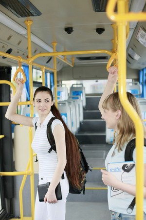 student travel: Women travelling in a bus Stock Photo