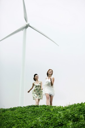 Women holding hands and running together Stock Photo - 8190026