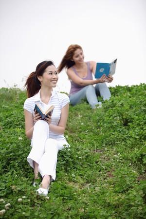Women reading outdoors Stock Photo - 8190069