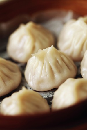 Close-up of xiao long pao in bamboo steamer