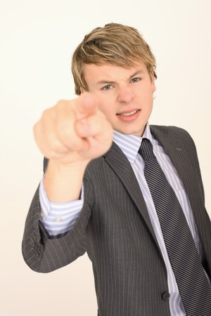 Angry businessman pointing with finger photo