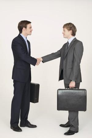 contentment: Businessmen shaking hands