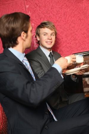 Businessmen enjoying coffee photo
